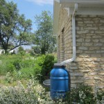Rain barrel and rain garden at Clow House